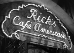 Rick's American Cafe sign (use the outline design and font and hang over the entrance to the tent and on signs pointing to the party location)