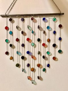 This whimsical and vibrant sun catcher to brighten up any space! The cheery colors will perfectly compliment all seasons and every hint of light will bring a smile to your face. It falls into a lovely shape when hanging. A variety of colors are featured Stained Glass Projects, Stained Glass Art, Glass Wax, Sea Glass, Diy Wind Chimes, Beaded Curtains, Suncatchers, Diy Home Decor, Decoration