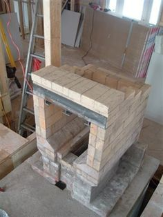 The intention of this articles to give a course by course account of the construction of the core and upper chamber oven. Diy Pizza Oven, Pizza Ovens, Wood Stove Heater, High Ceiling Living Room, Rocket Stoves, Barbacoa, Fireplace Design, Bauhaus, Solar