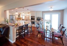 Contemporary Kitchen with Hardwood floors, Breakfast bar, Astoria Granite, Clemson Prismatic Single Pendant, flush light