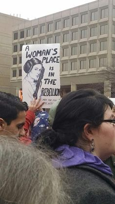 "#WomensMarch ""A woman's place is in the rebellion. May the force be with you,"" at the Women's March on Washington, January 21, 2017   Photo credit: Lester Howard Andrist"