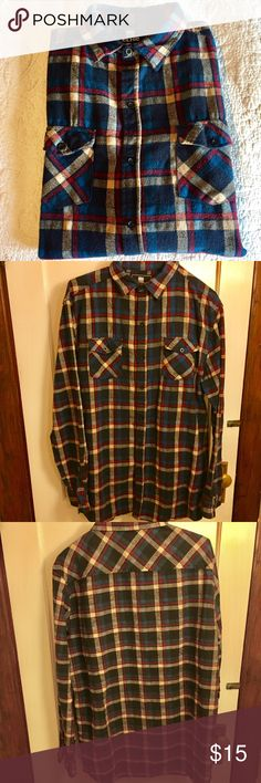 Men's heavyweight flannel 2XL A heavier weight flannel, 100% cotton by ELXR from Zulily's. Button up with 2 bottomed front pockets.  Sleeves have 2 buttons at wrist. Burgundy, blue, black, and cream Plaid.  Excellent condition.  Worn just a few times. No flaws. ELXR of Zulily Shirts