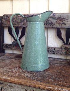 green speckled enamelware pitcher