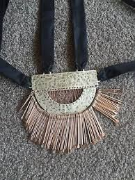 Image result for sass bide to have to hold necklace