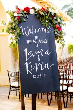 Reception signage with flowers by Sweet Marie Designs. Photo by Mason & Megan Photography (via MODwedding).