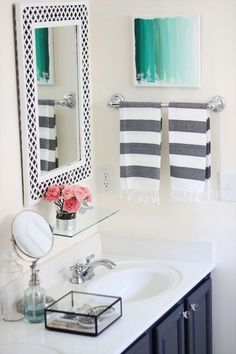 Love the mirror and navy cabinet!