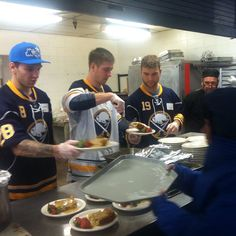 #Sabres Zemgus Girgensons, Mark Pysyk and Cody Hodgson serving lunch for Buffalo City Mission. [Oct 22, 2013]