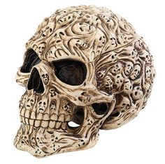 Skull's Soul Spirit Sculptural Box by artist Anne Stokes.  Etched with the tragic faces of lost souls, the top of this skull lifts to reveal a hiding place for your Gothic talismans. Cast in quality designer resin with an aged bone finish.