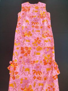 1960's The Vested Gentress Vintage Pink Floral muumuu w/warthogs and hibisci.