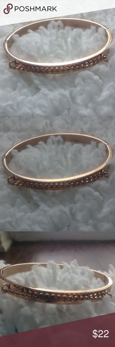 Gold Bangle Bracelet Woman's This is the sweetest bracelet. It is a bit on the smaller side, and shines so nice in the light. It has clasp closes on either side. The braided gold on the top, just makes it charming. Bundle! It saves so much on shipping. None Jewelry Bracelets