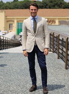 Casual spring groom in navy pants and bone or cream blazer