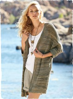 The essence of ease, our pima mesh cardigan is knit in striated rows of tweeded oatmeal, honey and charcoal pima. Buttonless placket; ¾-kimono sleeves; reverse jersey trim.