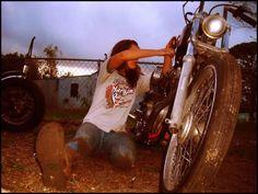 Female Harley enthusiast wrenching... rad!