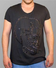 Skull safety pin shirt.