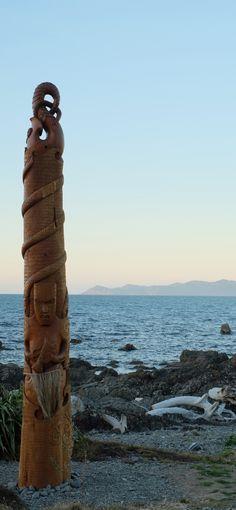 Pou whenua at Pukerua Bay at dusk - Porirua, Bottom of North Island, New ZealAnd