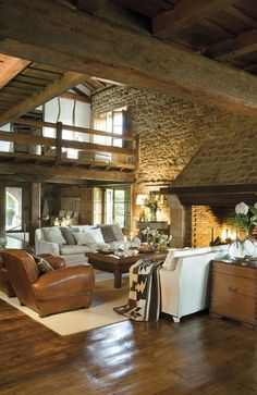 Extremely cozy and rustic cabin style living rooms - large room, open fireplace, mix of elements: stone, wood, leather, cozy fabrics