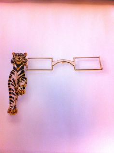 La lorgnette de Wallis Simpson, she must of loved cats, but she had pugs. It would be lovely to pull these out to look at small print.