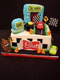 Cars 2 cake!   Rice krispy treat car wash with twizzlers and gas pump. The cars are toys.