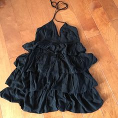 Black dress Summer fun black dress, ties around neck. Size 8 on tag but runs small Divided Dresses Mini