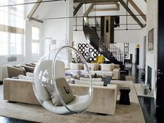 open space, high ceilings, whites & nuetrals, and dome chair?? LOVEEEEEEEEEEEEE!