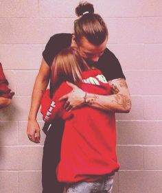 She's holding on to Harry like he's her lifeline! So true for many of us Directioners:)