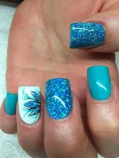 Glittery Blue Nails with Flowers for Detail.