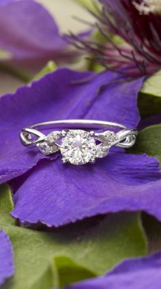 wispy vines of white gold entwine toward lustrous marquise diamond buds in this nature-inspired trellis ring