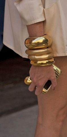 gold stacked bangles.