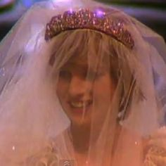 Lady Diana's happiness shinning through her veil.  The gorgeous Spencer Tiara showing off it's shimmer & shine.  Diana looked beautiful.