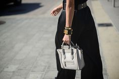 All black ensemble perfectly accessorized w/ gold-tone jewelry & classic Céline bag in white #StreetStyle