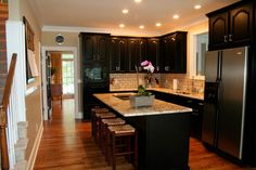Almost what I have in my head - black cabinets, old subway tile, light granite but with darker wood floors