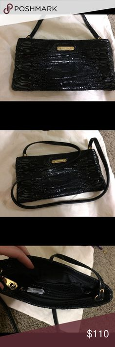 Michael Kors clutch Black shiny Michael Kors with a removable chain, new without tag. Michael Kors Bags Clutches & Wristlets