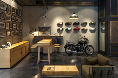 Royal Enfield store by Lotus, New Delhi – India Garage Design, House Design, Online To Offline, Loft Floor Plans, Loft Flooring, Showroom Interior Design, Retail Interior, Burger Bar, Retail Store Design