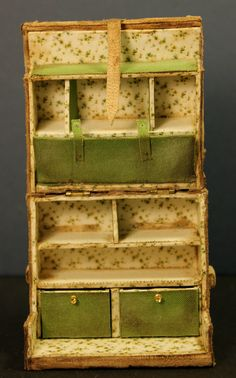 Inside the miniature trunk is an organizer's dream, with lots of cubbies and pockets to pack clothes.