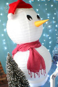How about making this cute snowman from white paper lanterns! See more Christmas party ideas at CatchMyParty.com #holidaycraft #partyideas #christmasdiy