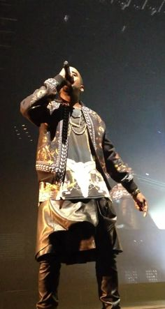 Kanye West rocks a leather Givenchy kilt for Watch the Throne & the #121212concert for Sandy Relief