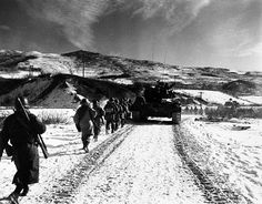 These are some of the 385 able-bodied survivors of the 2,500 army 7th Division men caught in a series of Chinese ambushes along the eastern shore of the Changjin (Chosin) reservoir in late November, 1950. (U.S. Marine Corps photo.)