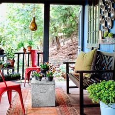 My spring must-haves: Punchy red cafe chairs, a galvanized metal trunk, a vintage Oriental rug, and tons of potted plants. Take me here! #outdoorliving #upgrades | Photo: Laura Moss | thisoldhouse.com