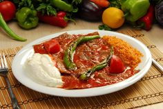 Iskender is the name Alexandre.  Iskender is a kind of kebap prepared from thinly cut döner over pieces of pide served with yoghurt, tomato sauce and melted butter. Tomato sauce and boiling butter are sometimes poured over the dish at the table. Iskender Kebap took its name from Iskender Efendi who lived in Bursa in the 19th century and invented Iskender Kebap. Kebapci Iskender is now a trademark and the grandsons of Iskender Efendi still run the restaurant in Bursa.