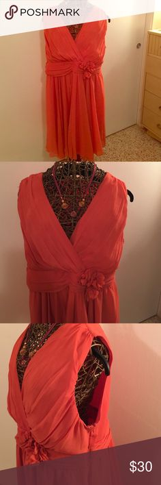 Coral party dress, sheer overlay with side zipper Fun and flirty coral dress, empire waist with shirred overlay, embellished flowers with beading and swing type skirt. Jonathan martin woman Dresses