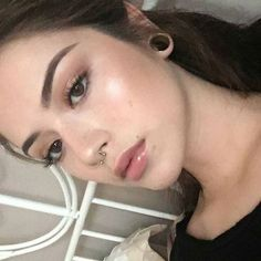 Simple makeup and septum.