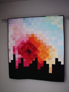 Pixel quilt (skyline w/ some diagonals)  I adore the way this quilt uses colored fabric squares as pixels to paint a scene.