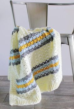 This crochet boxed block stitch blanket started with research of vintage stitches. I wanted to make a baby boy blanket using soft blue adding a touch of retro mustard and gray into the mix. But I wanted a classic stitch to accomplish the look. Crochet Afghans, Crochet Box, Easy Crochet Blanket, Crochet Stitches Patterns, Crochet Crafts, Crochet Projects, Free Crochet, Knit Crochet, Crochet Blankets