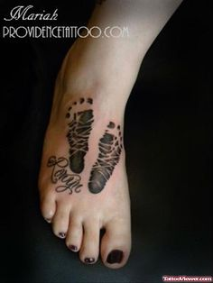 Girl Have Baby Footprints Tattoos