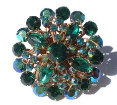 Vintage Rhinestone Brooch with Emerald Green Stones and Filigree Backdrop on Gold Tone Brass - Vintage Costume Jewelry