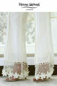 Best 11 Designer Indian & Pakistani White Embellished Trousers available in Salwar Trousers, Embroidered Trousers and Bootcut trousers. Designed in London UK. Free delivery over White raw silk trousers with flowers and pearl embellishment. ̴Ì_These Salwar Designs, Blouse Designs, Dress Designs, Kurti Designs Pakistani, Moda Fashion, Fashion Pants, Fashion Dresses, Stylish Dresses, Workwear Fashion