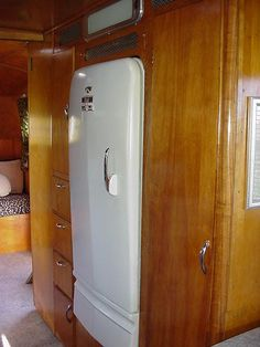 Seriously in LOVE with this fridge and the wood interior of this 1951 Spartan Trailer