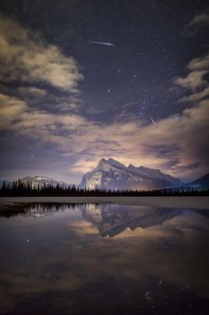 Night Blaze - A wonderful celestial show last night here in Banff National Park, with Procyon and Orion rising over Mount Rundle and a Geminid meteor ripping across the sky above the iconic peak. The meteors kept showing up outside (or on the edge of) the frame, or they weren't bright enough to show in a 6-second exposure. Finally one showed up in the right spot!