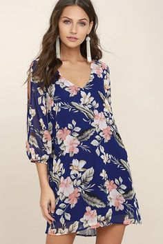 Lulus Exclusive! When it's time to shift your gears into glamor mode, the Shifting Dears Royal Blue Floral Print Long Sleeve Dress is our most dearly beloved dress! Royal blue chiffon, with a pink, white, and grey floral print, forms a roomy shift silhouette with a deep, scoop neckline and a flared shape that flows into an asymmetrical, concave hemline. Long, sheer sleeves have on-trend, cold shoulder cutouts that open all the way to the cuffs.