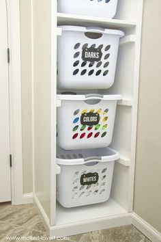 DIY Laundry Basket Organizer (...Built In). What a perfect organization idea to keep the laundry separated and out of the way. Ready to go on laundry day!